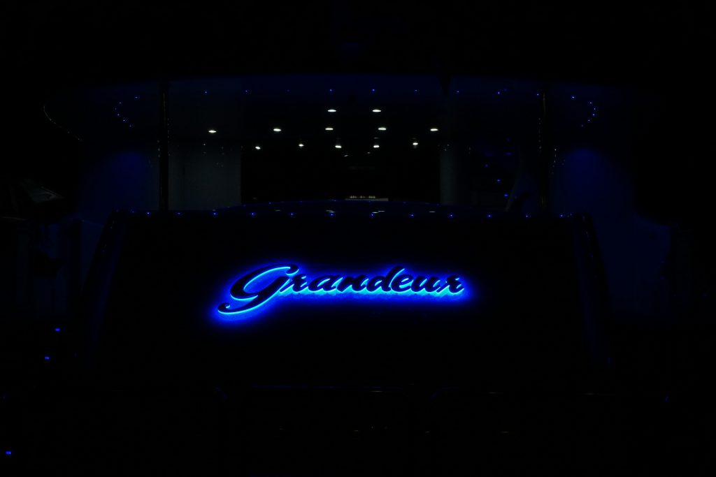Granduer lettering in blue lights